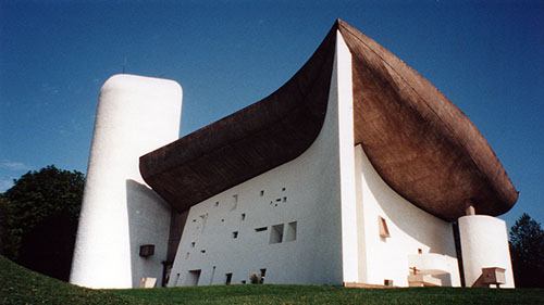 Le Corbusier is the inspired architect of Chapel of Notre Dame in Ronchamps, France