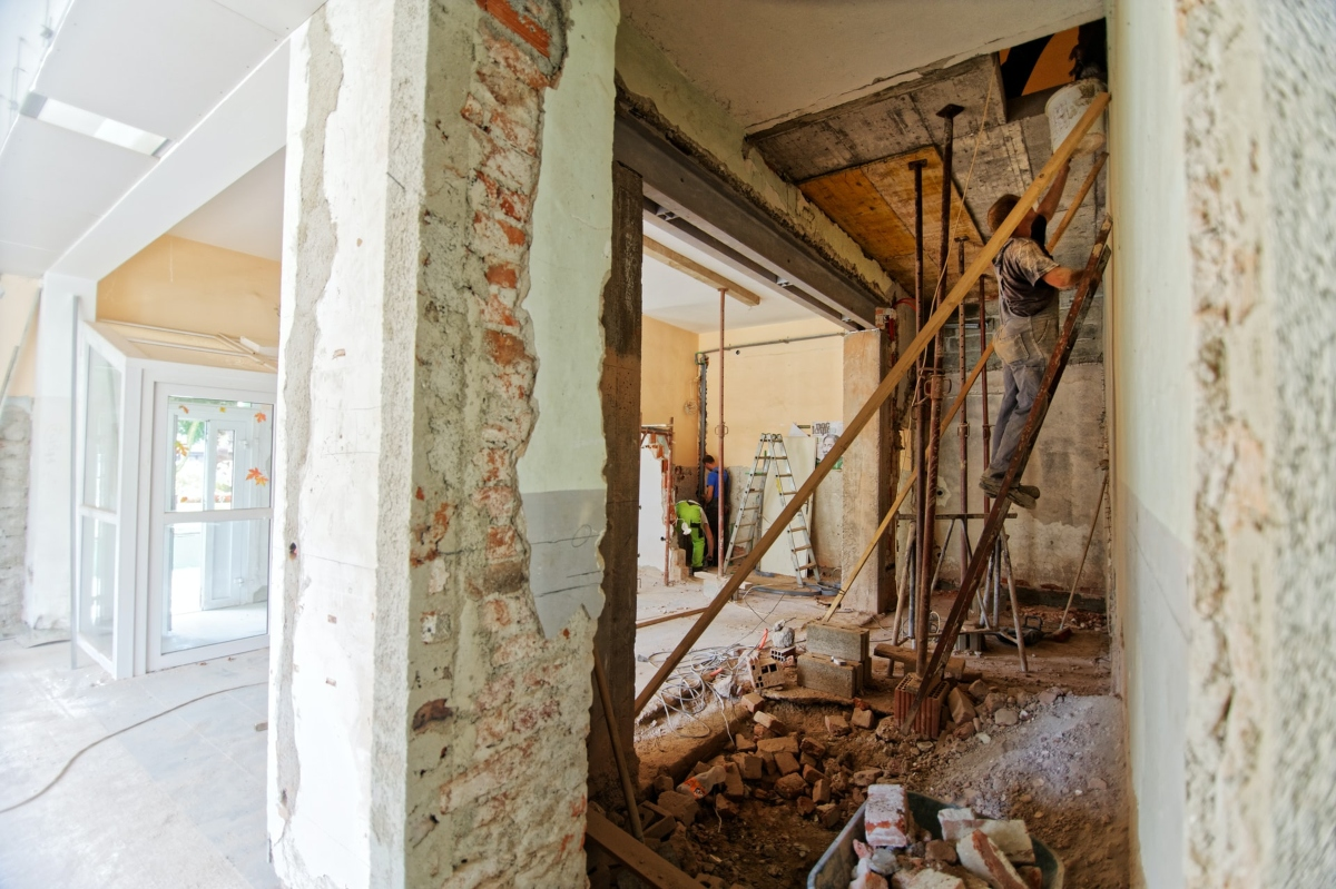 Professionals renovating a house in Spain