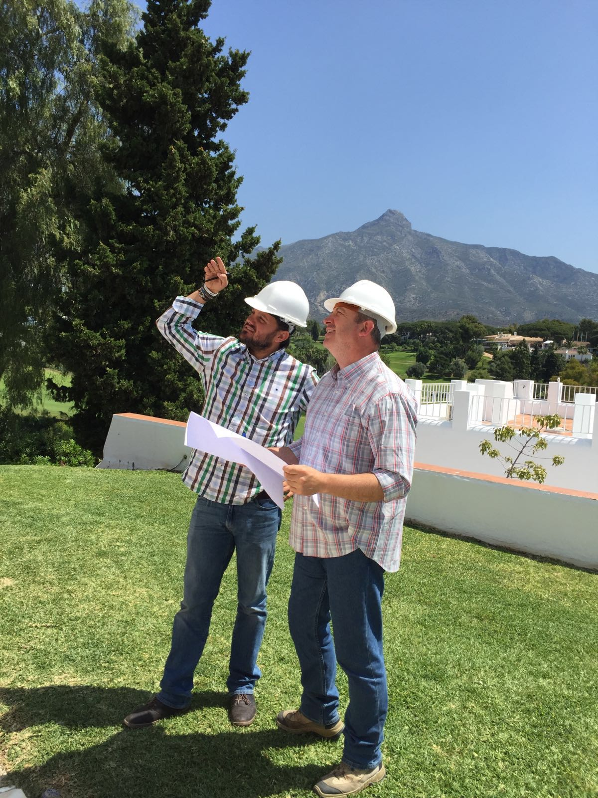 Experts surveying before buying land in Spain